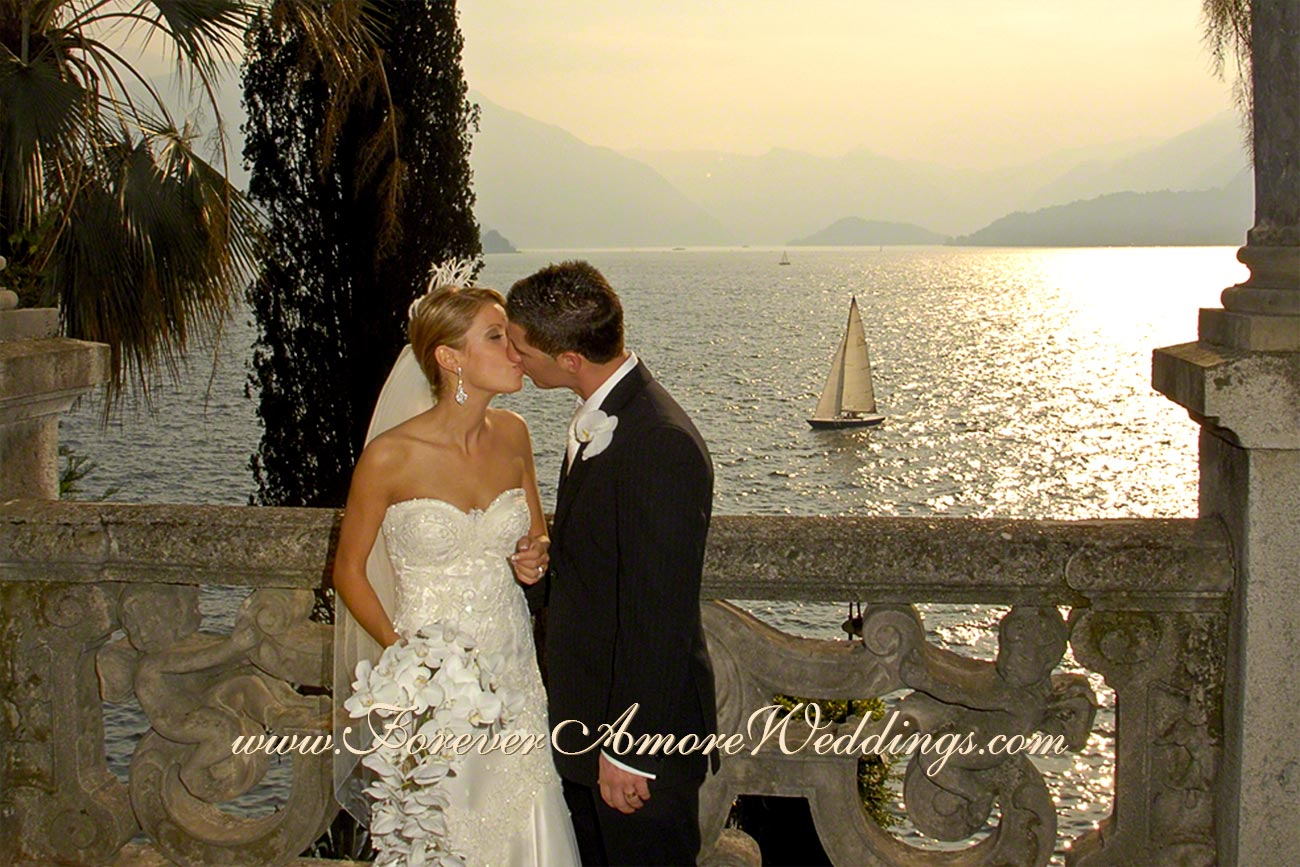 romantic bridal couple kissing at varenna lake como