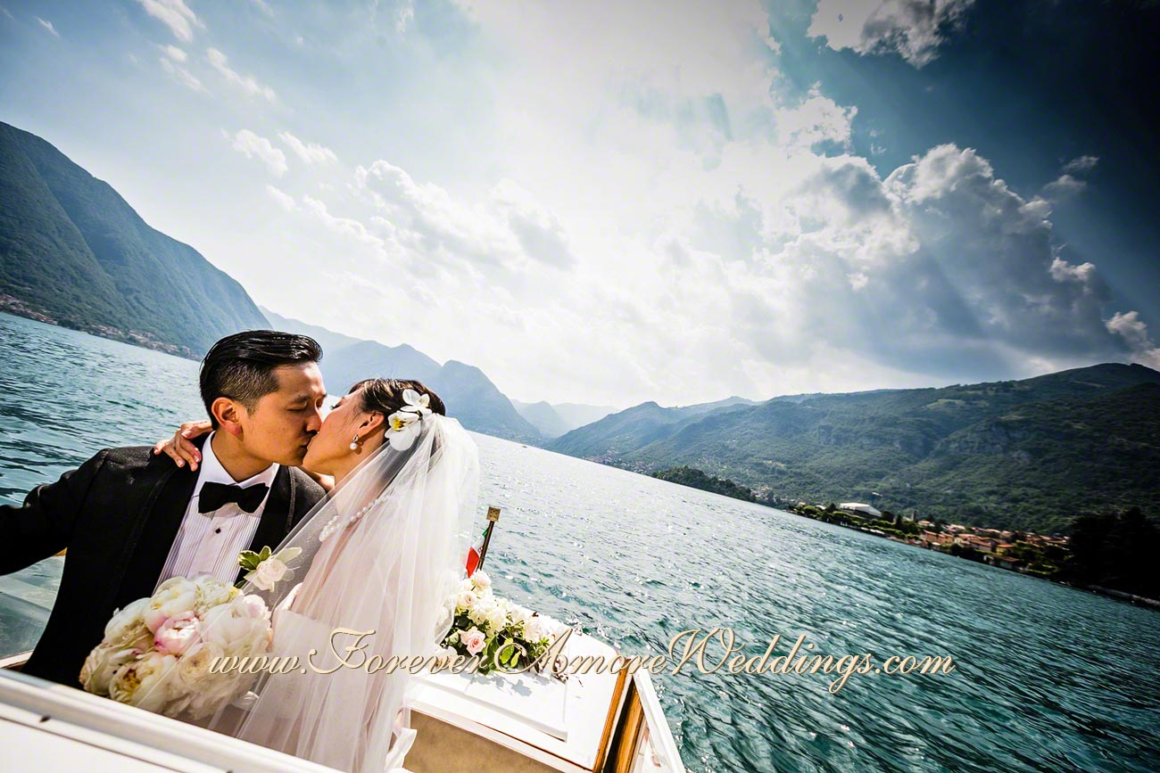 chinese bridal couple kissing at lake Como